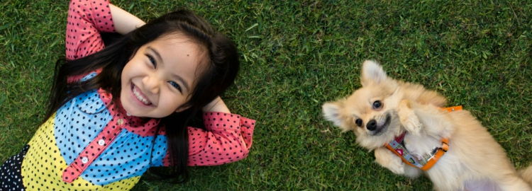 stock-photo-happy-asian-girl-with-her-doggy-portrait-lying-on-lawn-193708376_0.jpg