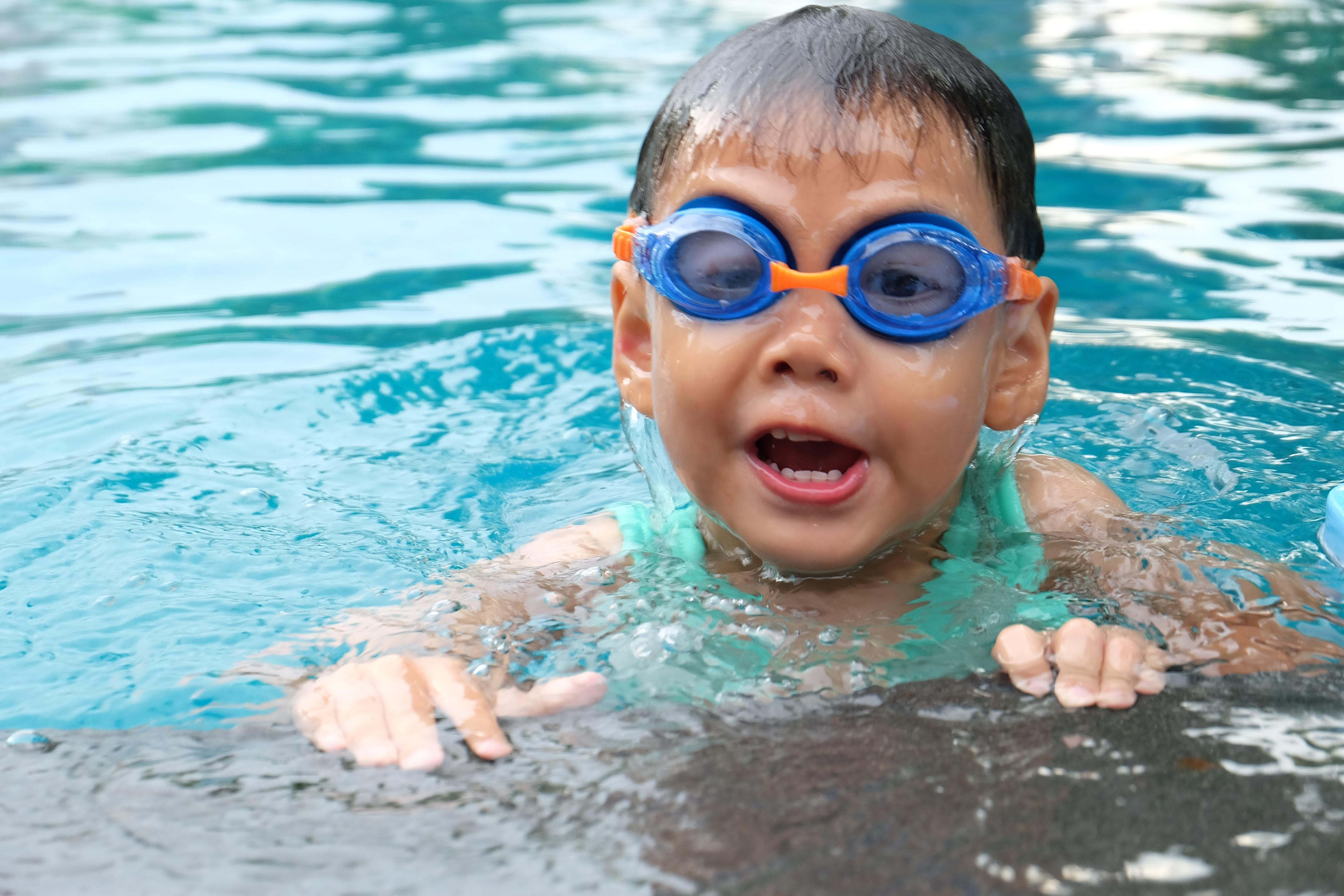 Photo of boy swimming in water.