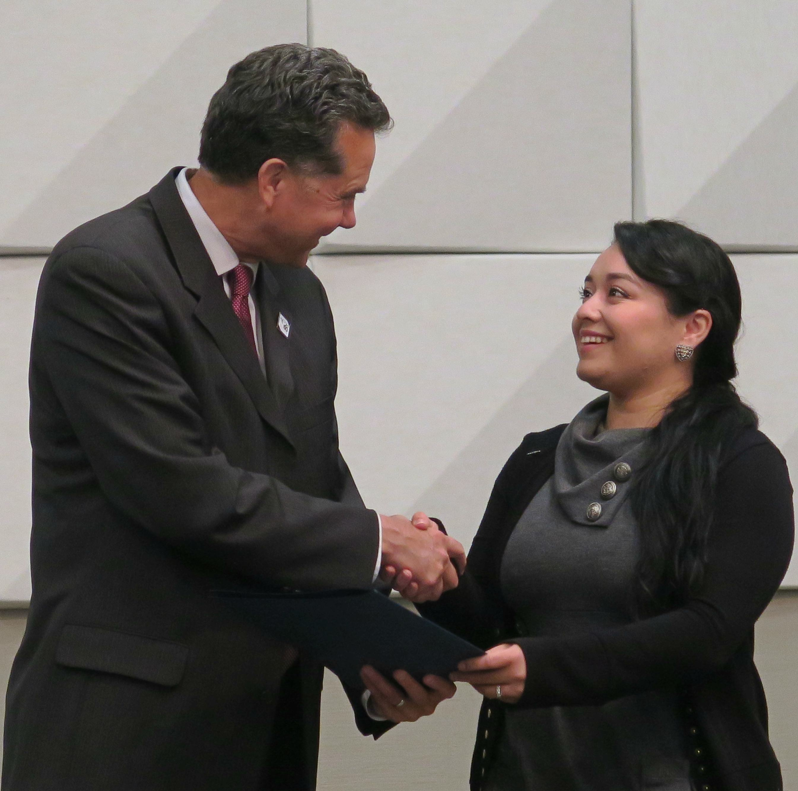 Photo of City Manager Scott Stiles with local college graduate