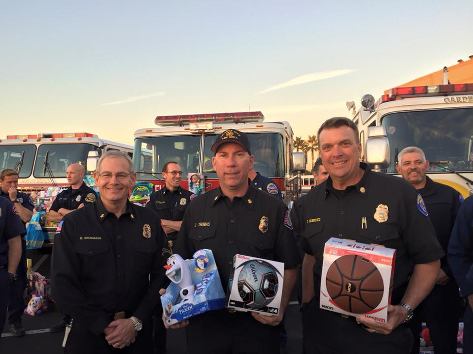 Fire Chiefs, Bruegman (AF&R), Thomas (OFD), and Schultz (GGFD).<br />Photo taken at the 2015 Spark of Love Toy Drive.