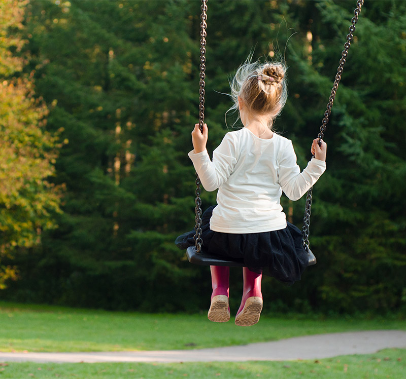 Little girl playing in park