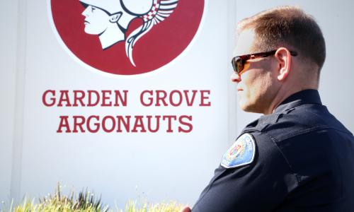 Photo of a school resource officer at Garden Grove High School.