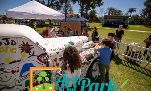 2020 Art in the Park cover photo of kids painting a car.
