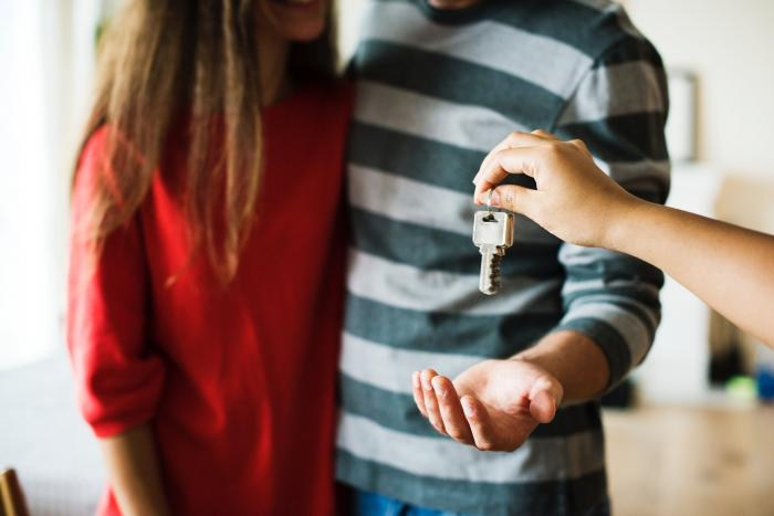 Stock photo of a couple receiving the keys to their home.