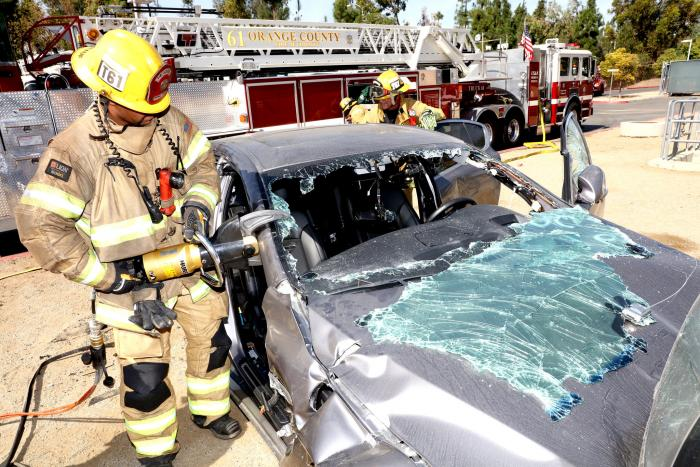 "Photo of a firefighter using the ""Jaws of Life."""