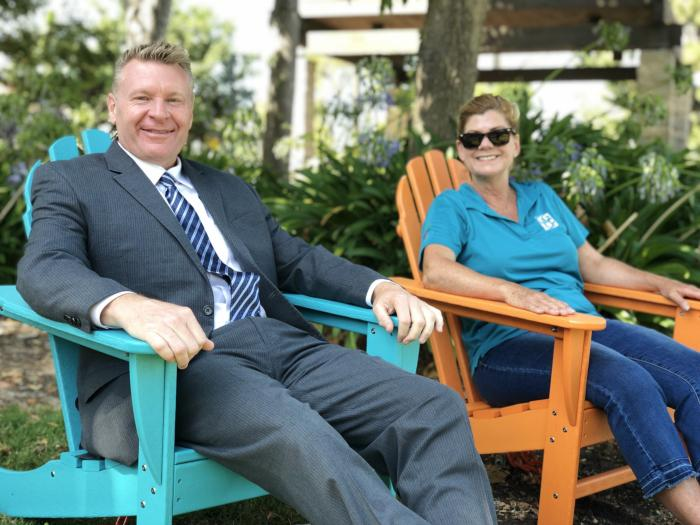 Garden Grove Mayor Steve Jones, with Community Services staff, enjoy the new Adirondack chairs in Civic Center Park.