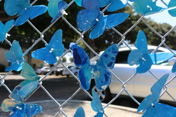 Hand-painted blue and marbled butterflies can be seen at the corner of Acacia Parkway and Grove Avenue.