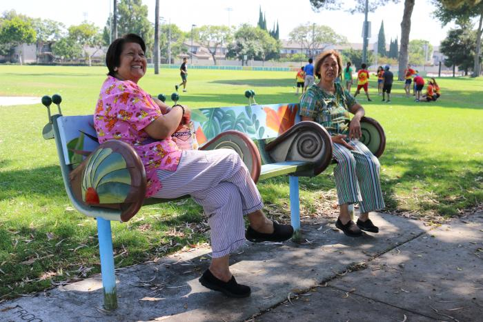 Park goers enjoy the snail family-inspired bench at Village Green park.