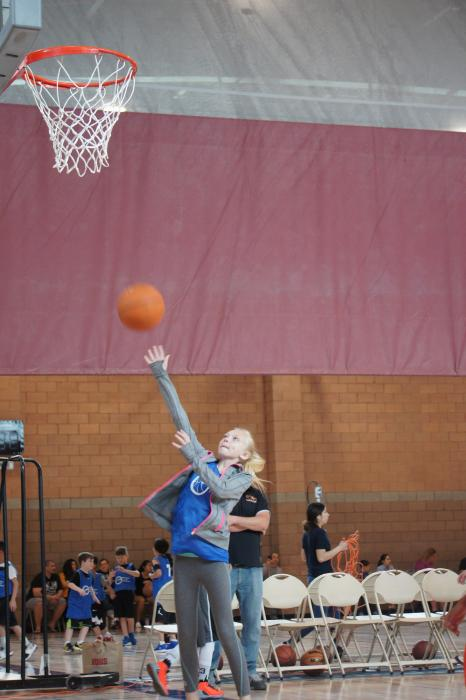 A jump shot being taken by a Youth Basketball League participant.