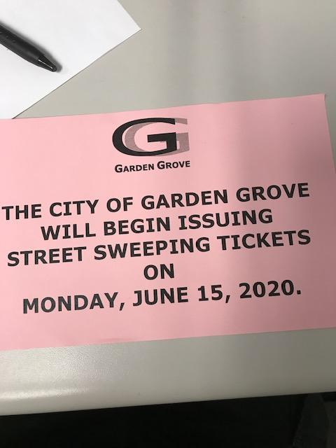 Street sweeping citation warning flyer.